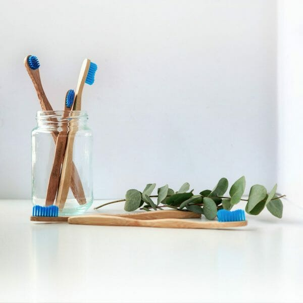 toothbrushes shown in an example of a social media marketing image for dentists